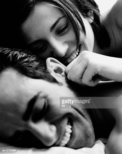 Woman Pulling Man's Ear in Bed