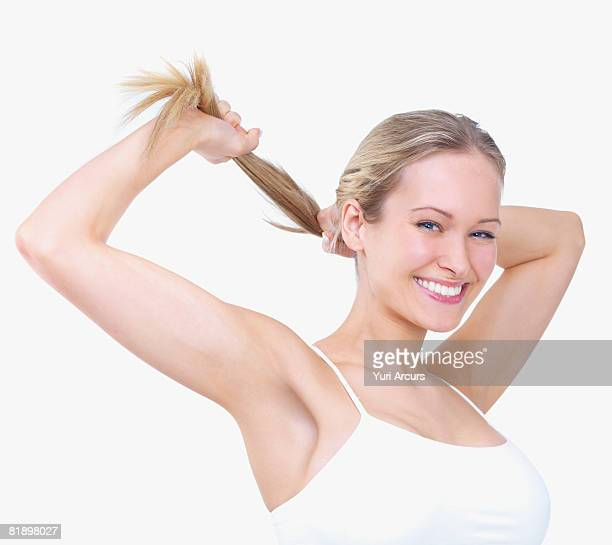 Woman pulling on ponytail
