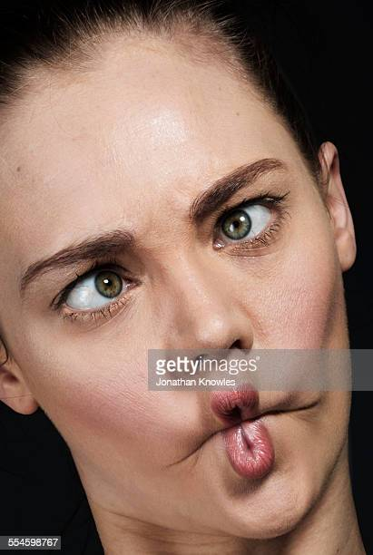 Woman pulling silly faces
