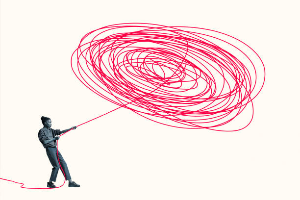 Woman pulling vibrant red rope from tangle