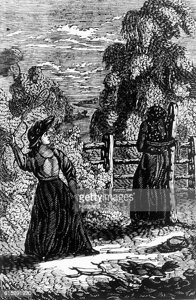 Woman pulls back arm to whip another woman who is tied to a post with a rope Book illustration from Bourne's Picture of Slavery 1834
