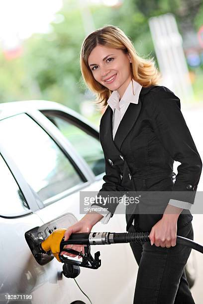 Woman pumping gas in gas-station.