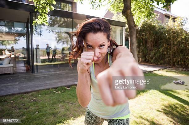 Woman punching the camera