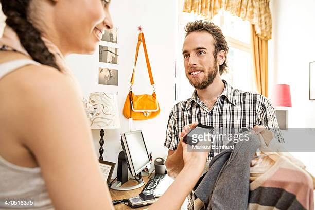 Woman purchase with mobile device.