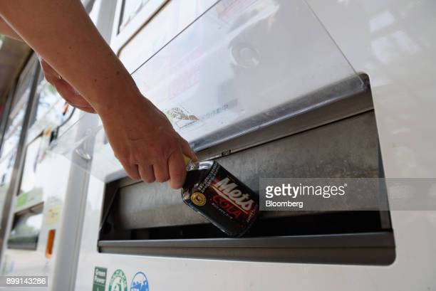 A woman purchases a drink from a vending machine in Kawasaki City Kanagawa Prefecture Japan on Friday June 23 2017 Japan's November retail sales...