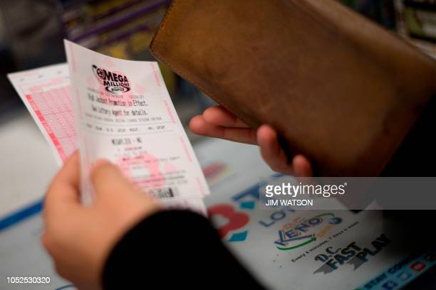 A woman purchases Mega Millions tickets in Washington DC on October 19 as the jackpot nears 1 billion dollars
