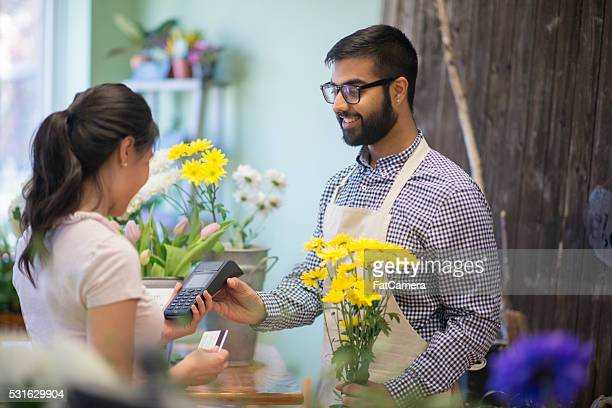 Woman Purchasing a Bouquet of Flowers