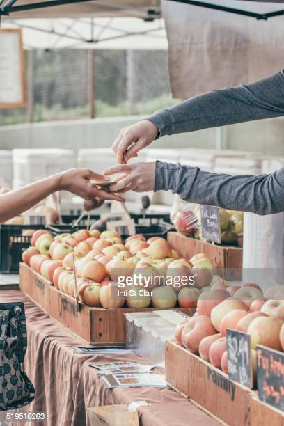 Woman purchasing produce at market