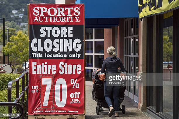 A woman pushes a baby stroller in front of a Sports Authority Inc store in Corte Madera California US on Tuesday May 24 2016 A judge overseeing the...
