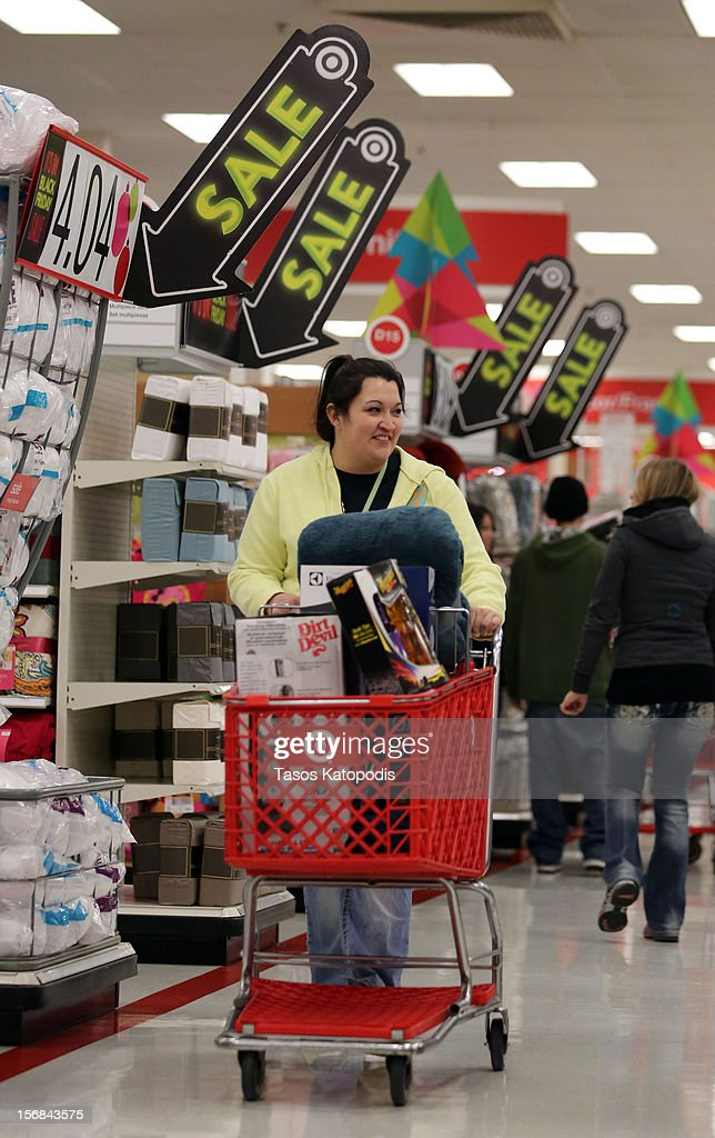 A woman pushes a full cart while shopping at a Target on Thanksgiving night November 22, 2012 in Highland, Indiana. Many stores got a head start on the traditional Black Friday sales by opening on Thanksgiving.