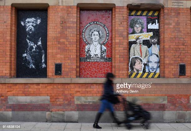 A woman pushes a pram past a mosiac of Emmeline Pankhurst outside Affleck's Palace in the Northern Quarter on February 6 2018 in Manchester England...