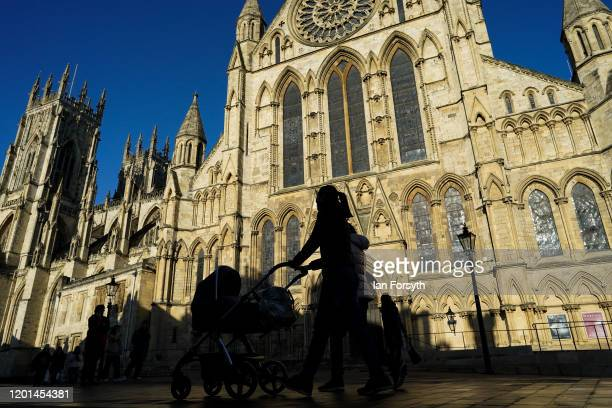Woman pushes a pram past York Minster on January 23, 2020 in York, England. Prime Minister Boris Johnson is considering a plan to relocate the House...