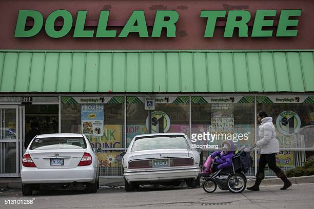 A woman pushes a stroller past a Dollar Tree Inc store in Detroit Michigan US on Saturday Feb 27 2016 Dollar Tree Inc is scheduled to release...