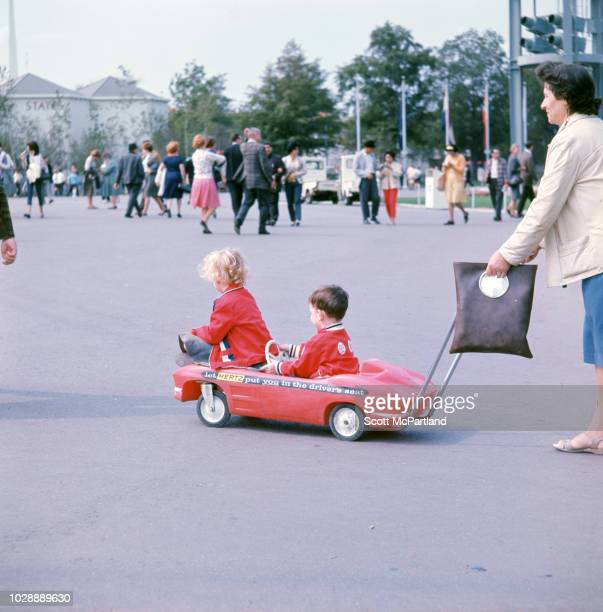 A woman pushes two children in a Hertzbranded stroller at the World's Fair in Flushing Meadows Park in Queens New York New York May 1965