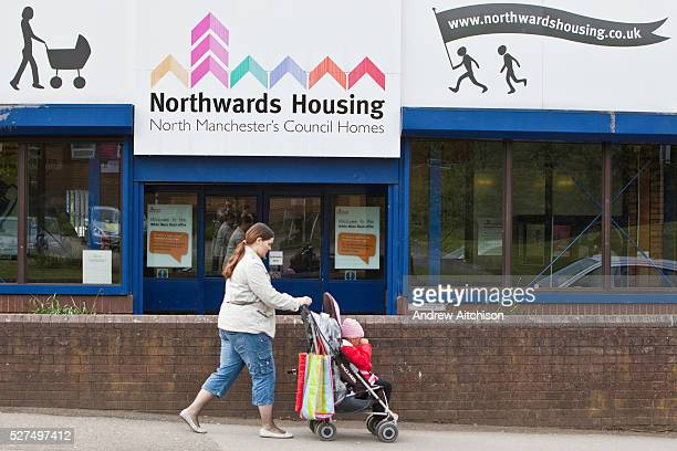A woman pushing a child in a pram walks past the office door of Northwards housing Northwards Housing has gone far beyond government standards in...