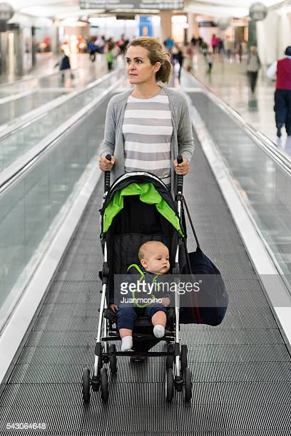 Woman pushing a stroller at the airport