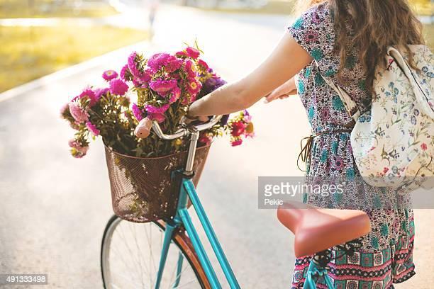 Woman pushing bicycle