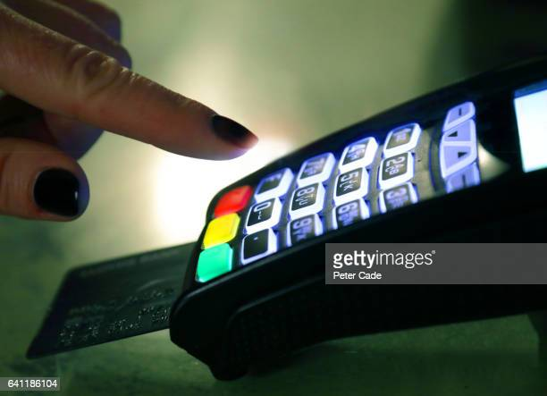 Woman pushing button on card payment device