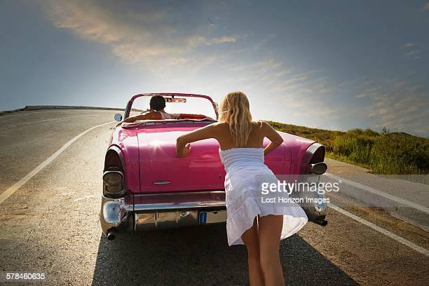 Woman pushing Convertible on road