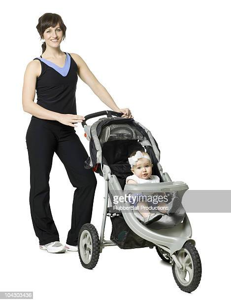 woman pushing her baby in a stroller