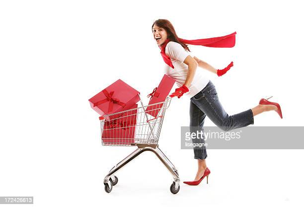 Woman Pushing Shopping Cart Containing presents