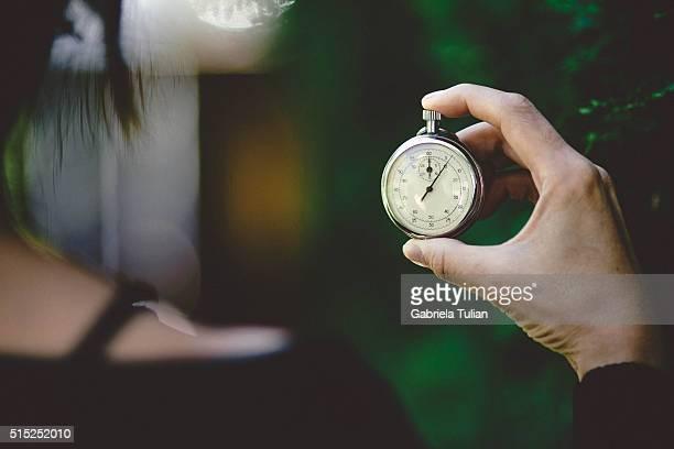 woman pushing stopwatch button