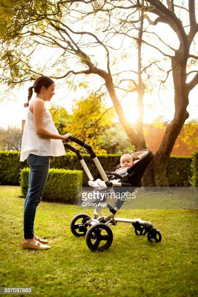 Woman pushing stroller with baby