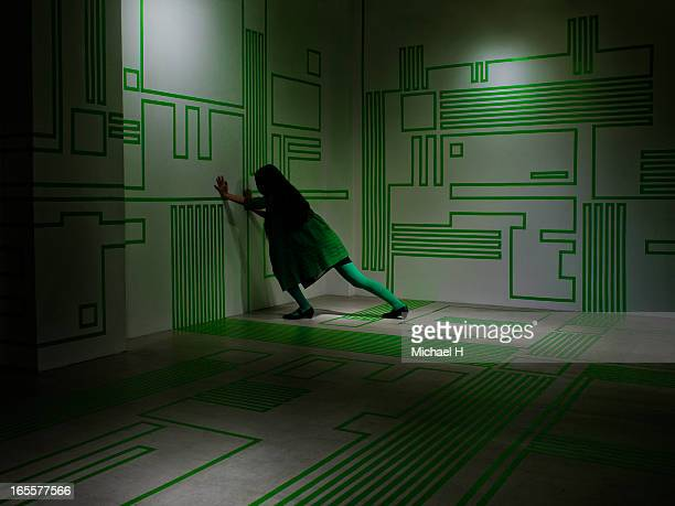 Woman pushinng a wall in the Circuit Board room