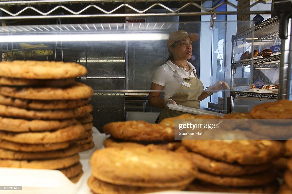 A woman puts out pastries and cookies at an Au Bon Pain store July 01, 2008 in New York City. New York City?s plan to eliminate foods containing trans fats went into the final stage today. Started a year ago, the trans-fat ban began in restaurants and applied only to spreads and frying oils. Beginning on Tuesday the ban extends to items such as baked goods, frozen foods, and doughnuts.