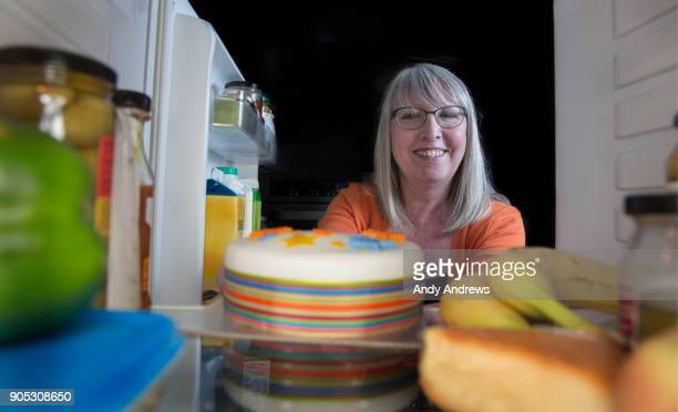 POV Woman putting a cake in a fridge