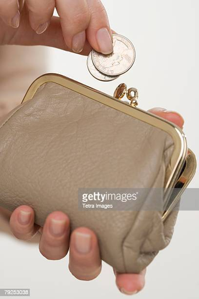 Woman putting change in coin purse