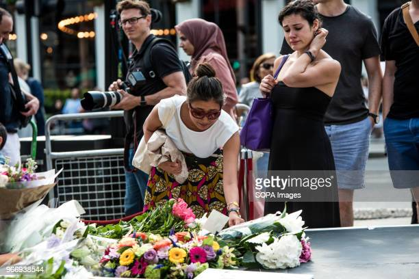 A woman putting down flowers in tribute for the victims of London Bridge A memorial service is being held near London Bridge to pay tribute to the...