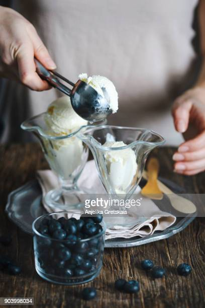 Woman putting ice cream in glass cup