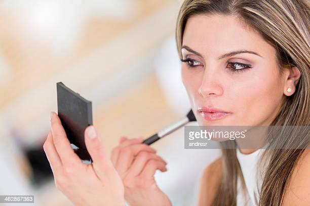 Woman putting make up on