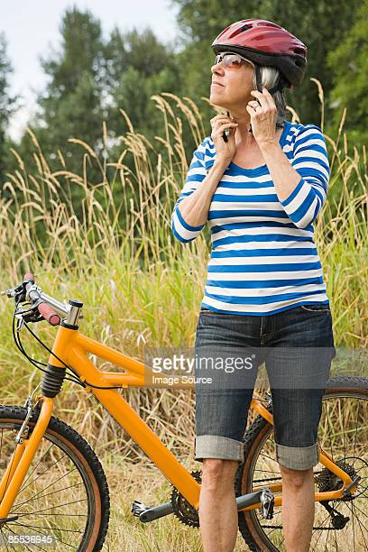 Woman putting on bicycle helmet