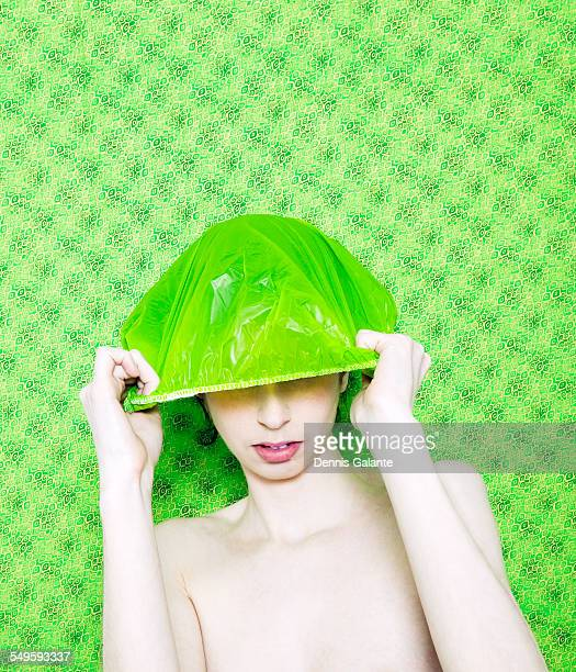 Woman Putting on Green Shower Cap