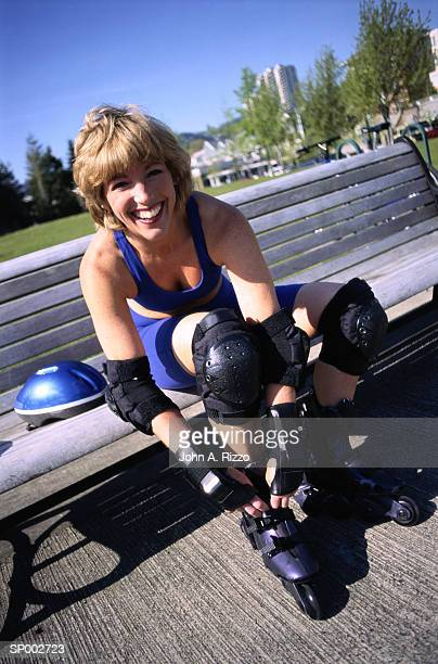 Woman Putting on Inline Skates