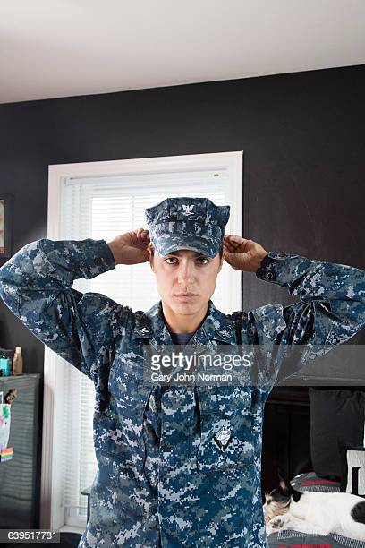 Woman putting on military uniform