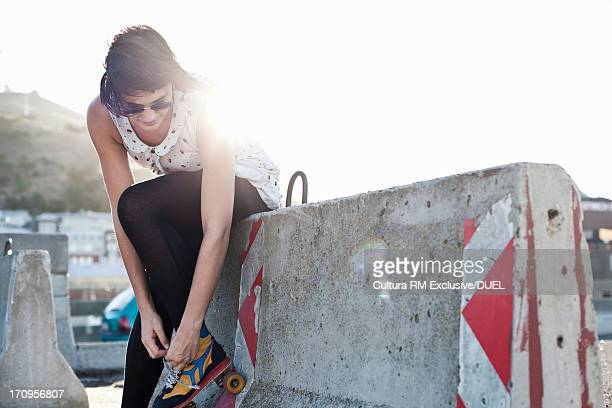 Woman putting on rollerblades