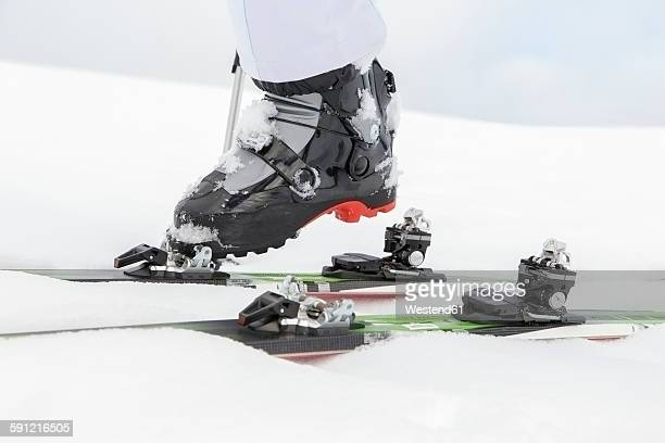 Woman putting on skis, close up