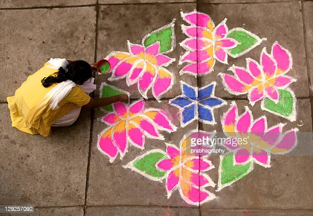 woman putting rangoli - rangoli stock pictures, royalty-free photos & images