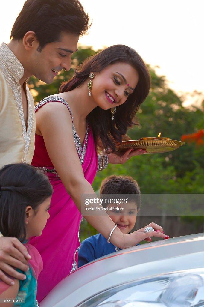 Woman putting tili on new car : Stock Photo