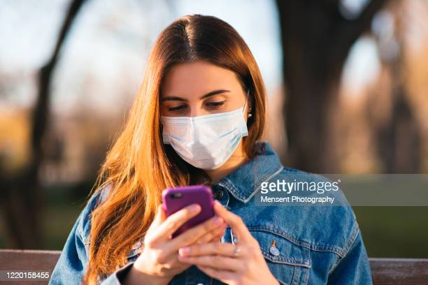 woman quarantined with face mask - audience free event stock pictures, royalty-free photos & images