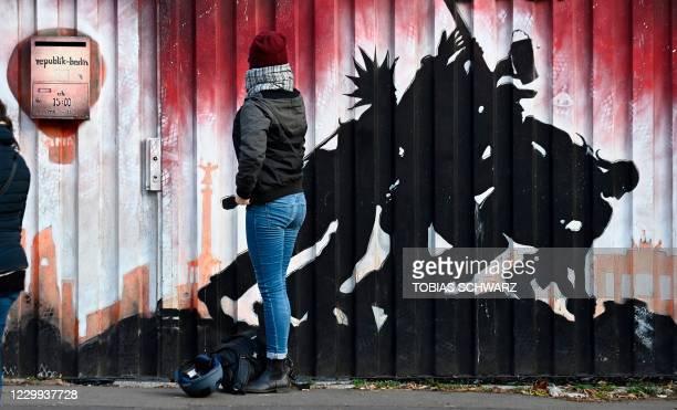 Woman queues to get a swab test on the novel coronavirus outside the KitKatClub night club in Berlin on December 4, 2020. - Berlin's legendary KitKat...