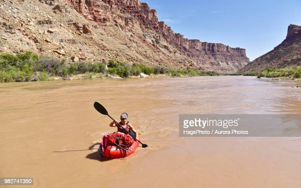 Woman rafting in river in Canyonlands National Park, Moab, Utah, USA
