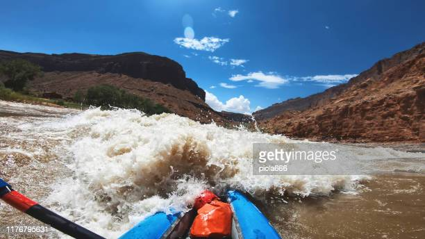 pov  woman rafting with kayak in colorado river, moab - hd format stock pictures, royalty-free photos & images