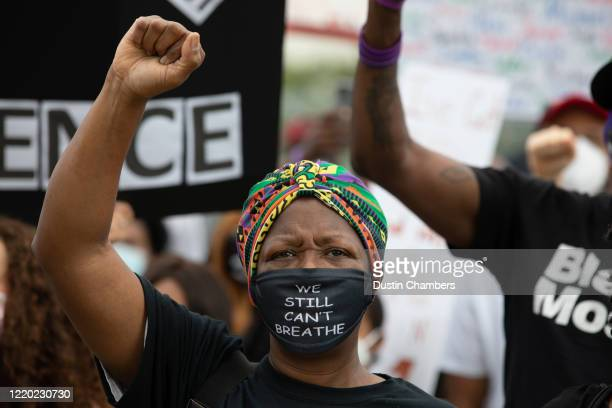 A woman raises her fist as protesters gathered for the March On Georgia organized by NAACP on June 15 2020 in Downtown Atlanta Georgia The march...