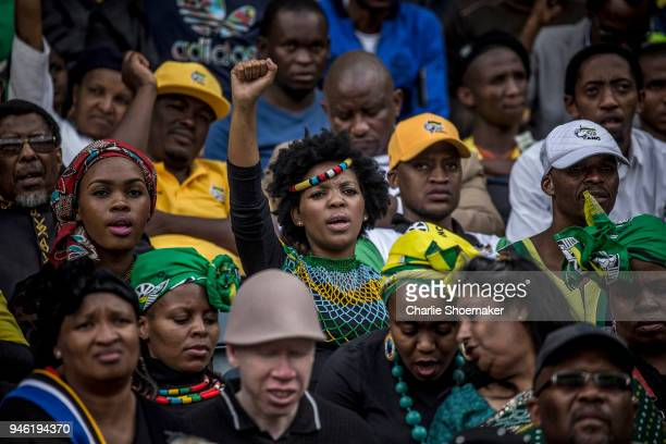 A woman raises her fist during the funeral for Winnie Mandela held at the Orland Stadium on April 14 in Soweto South Africa The former wife of the...