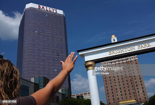 A woman raises her hand during a prayer for prosperity at an evangelical service along the Atlantic City Boardwalk on August 29 in Atlantic City New...