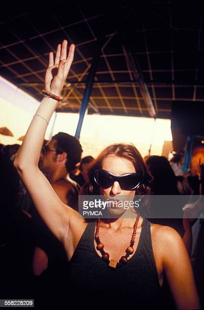 Woman raising arm to music Space Ibiza 1999